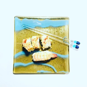 Fused glass plate in gold and blue with fused glass chopsticks